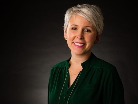 Former Iowa Senate GOP staffer Kirsten Anderson poses