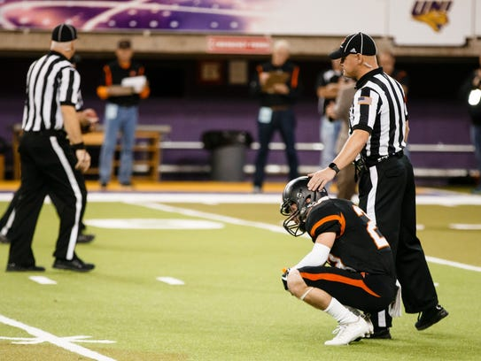 A referee consoles Solon's Storm Scott (23) after they lost to Xavier, Cedar Rapids 35-7 during their state semi-final football game at the UNI Dome on Thursday, Nov. 9, 2017, in Cedar Falls.