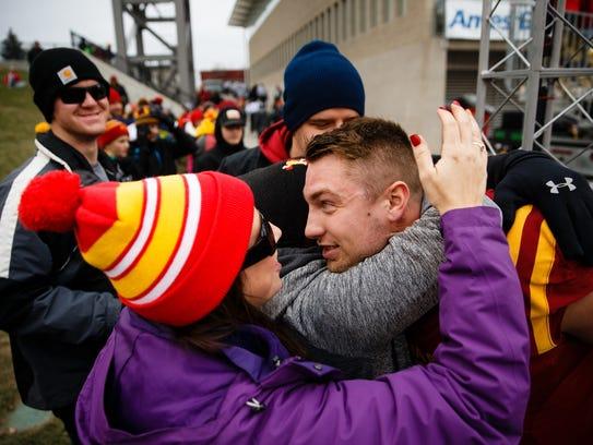 Darin Fitzgerald of Ankeny hugs her cousin Joel Lanning