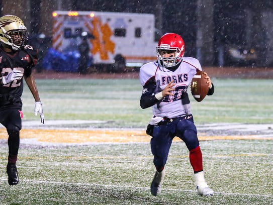 Chenango Forks quarterback Kris Borelli carries the ball against Cheektowaga during Saturday's Class B state semifinal at Union-Endicott. Borelli threw for two touchowns and ran for one in the Blue Devils' 48-28 victory.