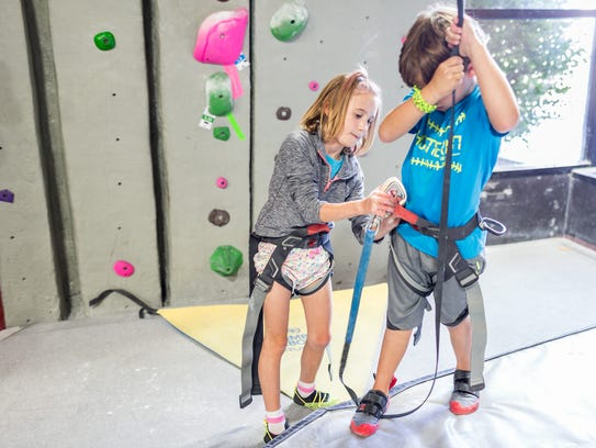 Kids spend their days playing games on the climbing