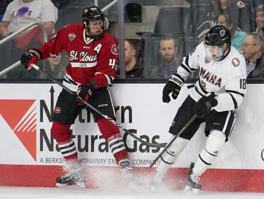 St. Cloud State's Blake Winiecki (left) and Nebraska