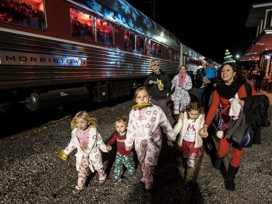 Isabella Wolcott, 4, of Dumont, her cousin Lucas Bauer, 2, of Wayne, Her sister Ava, 8, Lucas' sister Mikaela, , 5, and Lucas' mom Jackie arrive at the Polar Express event at the Whippany Train Museum, Dec. 7, 2017. Photo by Warren Westura for the Daily Record.