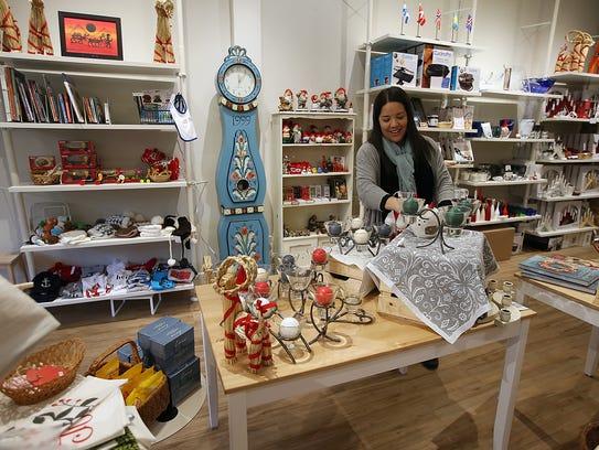 Kristin Klassert restocks a few items in between waves of customers to her Nordiska shop in Poulsbo.