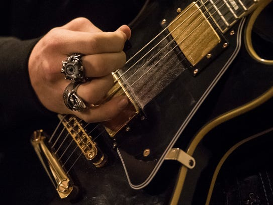 Noah Harrison's rings symbolize the band's message