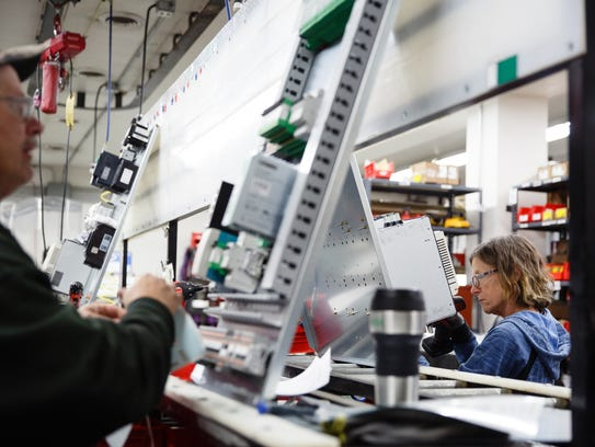 Sukup Manufacturing workers wire the nerve center for