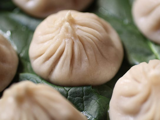Steamed juicy pork mini dumplings are shown at T.S.