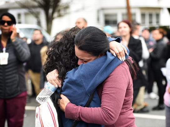 An unidentified woman hugs a student following a lockdown at Lodi High School on Thursday.