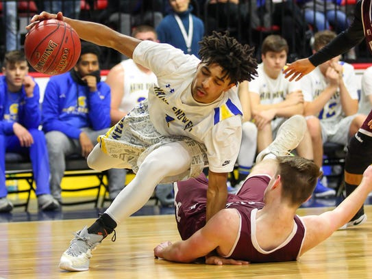 Maine-Endwell's Tyree Brodley drives past Johnson City's
