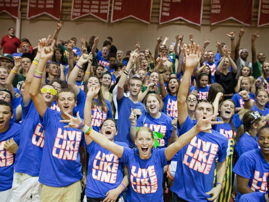The West High student section reacts to winning the