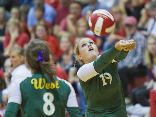 West High's Kelley Fliehler bumps the ball in the first
