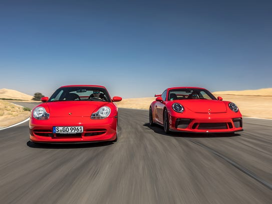 When compared to older versions of the GT3, the 2018 model - on right - features a wildly aggressive stance that includes a deep front spoiler and huge rear wing.