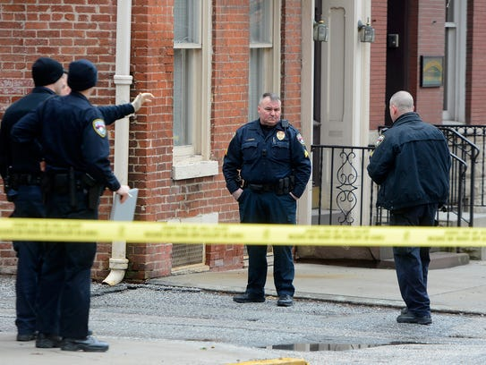 York City Police investigate a shooting in the first