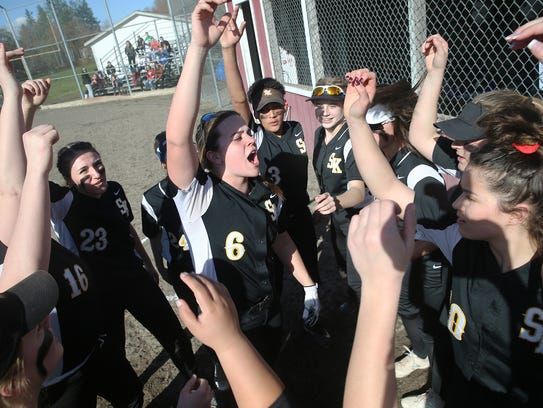 South Kitsap senior Statia Cermak (No. 6) leads the team in a cheer before a game against Port Angeles.