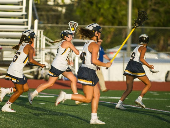Naples High junior Sophie Sullener carries the ball
