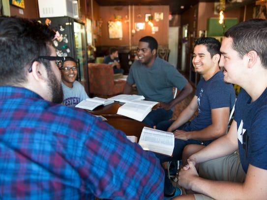 Young men talk during a Bible study at Biltmore Church.