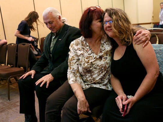 Sherri Pomeroy, right, is embraced by her sister Sylvia