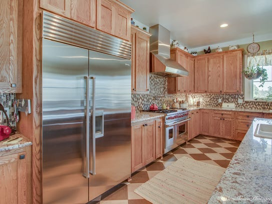 The kitchen offers top-of-the-line appliances, a 6