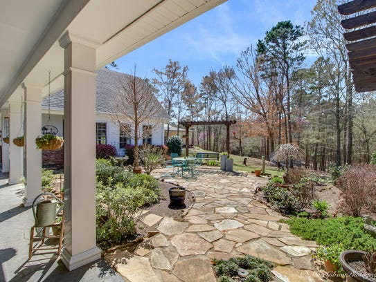 A 4,400 square foot wraparound porch is perfect for