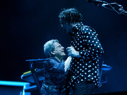 Jack White (right) dances with his mother, Teresa Gillis,