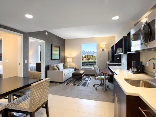 Bellevue 39 s home2 suites by hilton site sold for for Small lounge suites small rooms