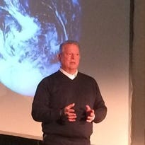 Former Vice President Al Gore speaks about the far-reaching consequences of climate change Tuesday at Ira Allen Chapel at UVM.