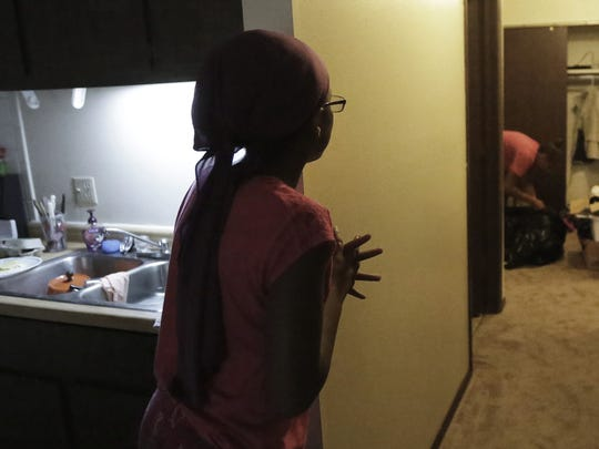 Kristen, daughter of Candace Williams, talks to her mother while preparing lunch as they begin unpacking and settling into their new apartment in Appleton.