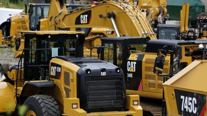 Caterpillar machinery sits at a dealership in Murrysville, Pa., Tuesday, July 25, 2017. (AP Photo/Gene J. Puskar)