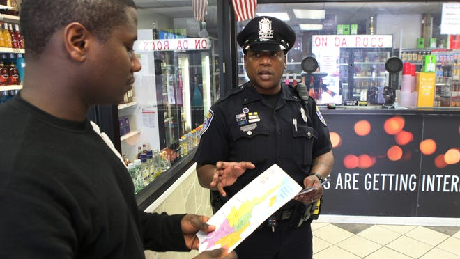 Officer Sammie Drayton Jr., an 18-year RPD veteran, stops in to talk with Jerrod Jones, owner of On Da Roc's Liquor, while on patrol on Dewey Avenue, part of the new Lake Section created as part of the reorganization of RPD. Drayton has patrolled some of the same territory in the past four years.