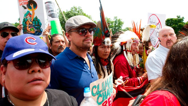 Actor Leonardo DiCaprio marches with a group of indigenous people from North and South America during the Peoples Climate March in Washington DC, on Saturday.
