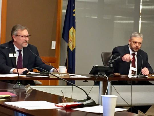 Montana State Fund Board Chair Lance Zanto, right, talks Nov. 29 about the lawsuit the board has filed against the state as State Fund CEO Laurence Hubbard listens.