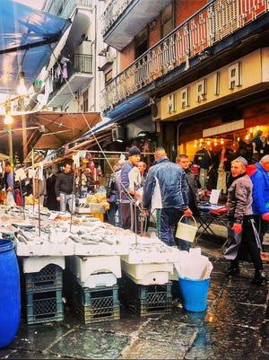Napoli locals visit Porta Nolana Market to shop for fresh seafood.