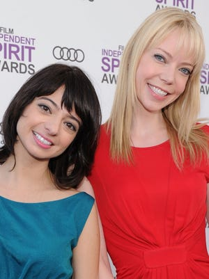 Riki Lindhome (right) and Kate Micucci are the comedic-folk duo Garfunkel and Oates.