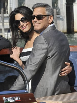 It's official: George Clooney is now husband to Amal Alamuddin.