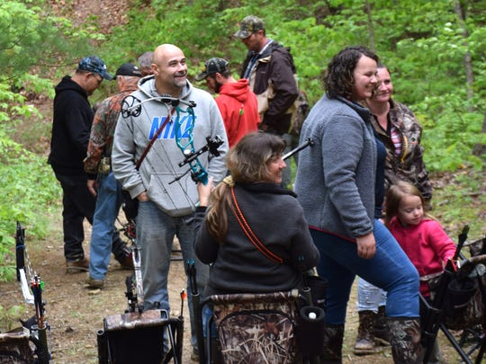 A group of shooters and their families wait their turn to shoot at a 3-D target during the first day of the Rinehart Targets R100 Traveling Archery Tournament on Saturday, May 6, 2017, at the Augusta Archers Club in Staunton. Over 450 shooters are expected to attend the two-day event.