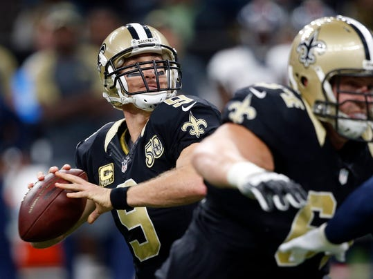 FILE - In this Sunday, Nov. 13, 2016 file photo New Orleans Saints quarterback Drew Brees (9) drops back to pass in the first half of an NFL football game against the Denver Broncos in New Orleans. The Saints play the Detroit Lions on Sunday, Dec. 4, 2016. (AP Photo/John McCusker, File)