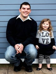 """Chris Lanier (left) is shown with his """"favorite niece,"""" Zoey Derouin, in this undated photo. Zoey continues to grieve over the loss of Chris, who died by suicide in 2013."""