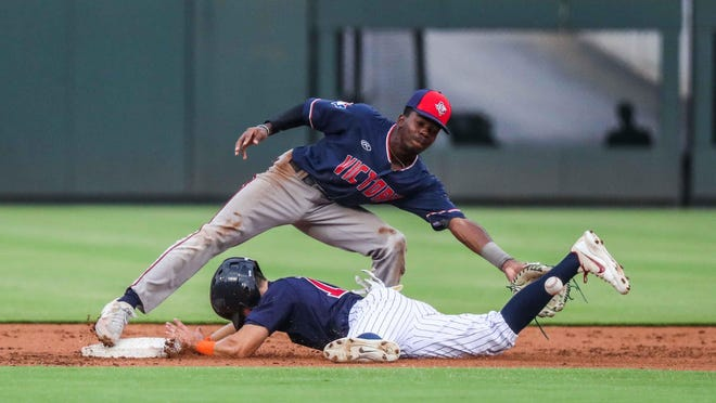 Jared McKenzie of the Round Rock Hairy Men reaches second base as Victoria Generals' Tre Richardson tries to make the tag at Dell Diamond in Round Rock on July 7.  The Hairy Men, a member of the Texas Collegiate League, close out their home schedule of the regular season this week.