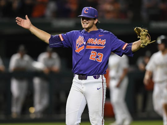 Clemson's Carson Spiers (23) reacts after striking out the side during the Tiger's NCAA Clemson Regional game against Vanderbilt at Doug Kingsmore Stadium in Clemson Saturday, June 2, 2018.
