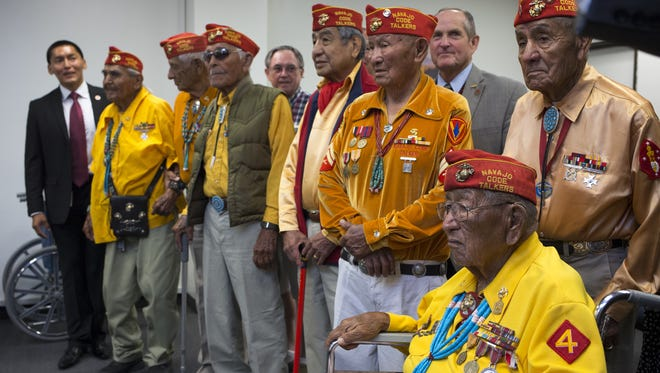 George James, third from right in the gold shirt, gathered in Phoenix with other Navajo Code Talkers in July 2014 when then-Gov. Jan Brewer designated a Navajo Code Talkers Day. James died Nov. 9, 2016.