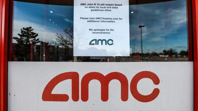 AMC John R 15 movie theater in Madison Heights, Mich. is closed due to COVID-19 infection rate spikes and has closed signs posted on the front doors on Nov. 21, 2020.