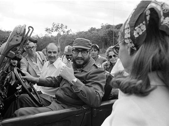In this May 8, 1975, file photo, U.S. Sen. George McGovern goes for a jeep ride with Cuban Premier Fidel Castro during the senator's visit to Cuba.