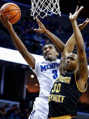 Memphis guard Jeremiah Martin (left) drives for a layup against Northern Kentucky defender Lavone Holland II (right) during second half action at the FedExForum in Memphis Tenn., Saturday, November 25, 2017.