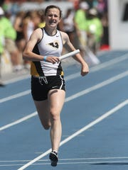 Southeast Polk freshman Sydney McNeeley runs the second leg of the Class 4A 4x200-meter relay at the 2018 state track meet held at Drake Stadium. Southeast Polk finished 20th in the event and third in the state track meet overall.