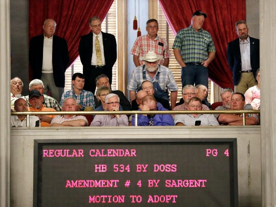People listen from the gallery during debate on Gov. Bill Haslam's road and bridge funding bill in the House of Representatives on Wednesday, April 19, 2017, in Nashville. A Republican effort to remove Tennessee's first gas tax hike since 1989 from Haslam's road and bridge funding bill was soundly defeated in the House on Wednesday.