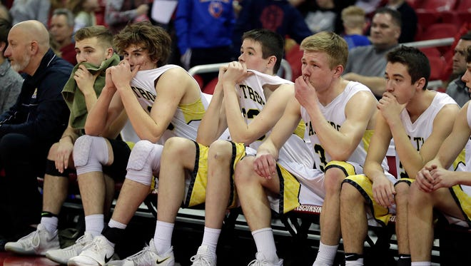 East Troy players show their disappointment after a 65-53 loss to Prescott in a WIAA Division 3 state semifinal Thursday at the Kohl Center.