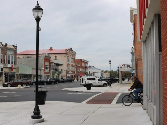 The downtown revitalization project  included vwater and sewer infrastructure improvements, as well as a complete redesign of the roads and sidewalks on Madison Street.