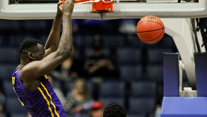 LSU forward Duop Reath (1) dunks against Mississippi State during the second half in a 2017 SEC Men's Basketball Tournament game at Bridgestone Arena Wednesday, March 8, 2017 in Nashville, Tenn.