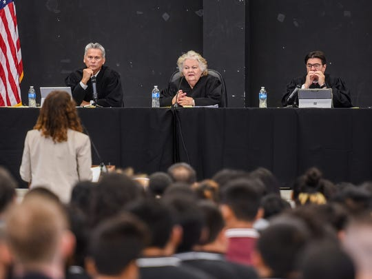 Supreme Court justices listen to oral arguments from Assistant Attorney General Marianne Woloschuk, during an outreach held at Tiyan High School in this May 1, 2017, file photo.