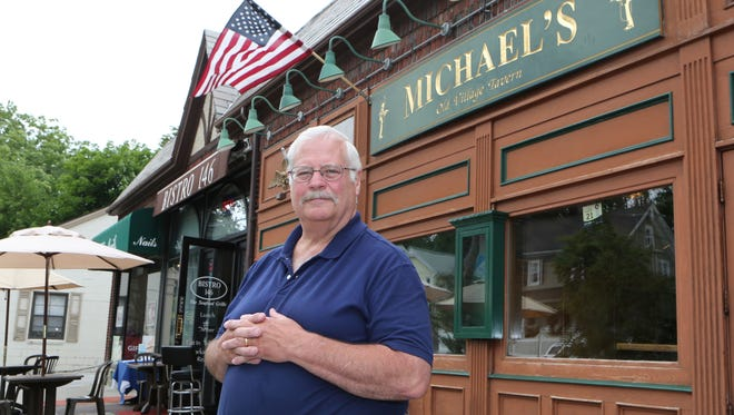 Doug Crossett, owner of Michael's Old Village Tavern in Pleasantville, stands outside of his establishment July 1, 2016. The tavern and two others owned by Crossett are closing.